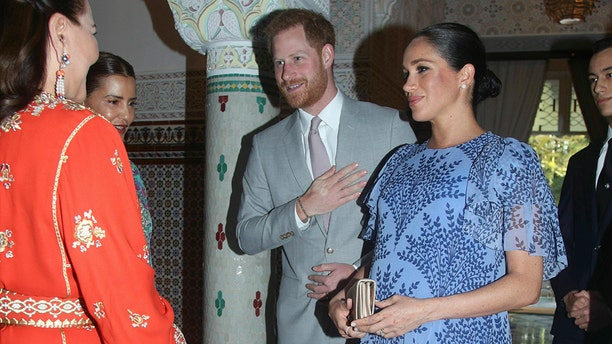 Britain's Prince Harry and Meghan, the Duchess of Sussex, are greeted by Princess Lalla Meryem of Morocco second left and Princess Lalla Hasna of Morocco, at the residence of King Mohammed VI of Morocco, on the third day of their tour of Morocco, in Rabat, Monday, Feb. 25, 2019.