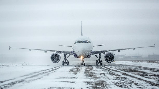 A small airplane in Indiana slid off the snowy runway, across afield and into the highway.