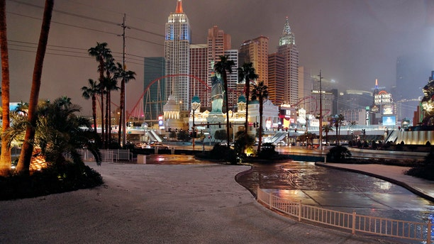 A dusting of snow covers an area along the Las Vegas Strip, Thursday, Feb. 21, 2019, in Las Vegas. A winter storm is expected to drop up to 3 inches of snow on Las Vegas' southern and western outskirts while other parts of the metro area will get rain mixed with snow.