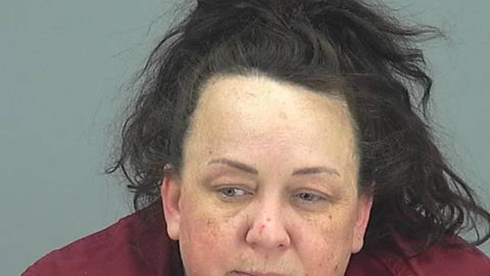 """Machelle Hackney, 48, is accused of abusing her seven adopted children and forcing them to star in videos posted on the YouTube channel """"Fantastic Adventures."""""""