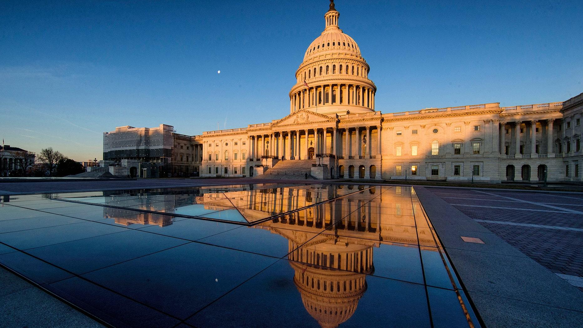 The U.S Capitol is seen at sunrise, Sunday, March 24, 2019, in Washington. (AP Photo/Alex Brandon)