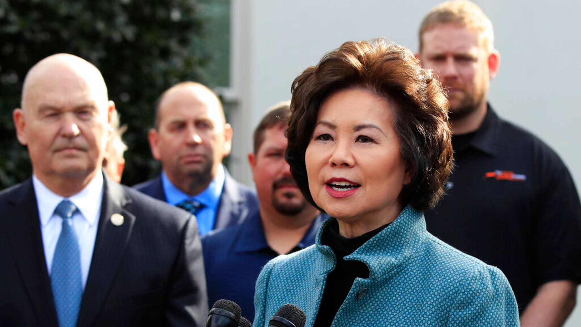 Transportation Secretary Elaine Chao, right, with U.S. Maritime Administration Administrator Mark Buzby, speaks to reporters outside the West Wing of the White House. (Associated Press)