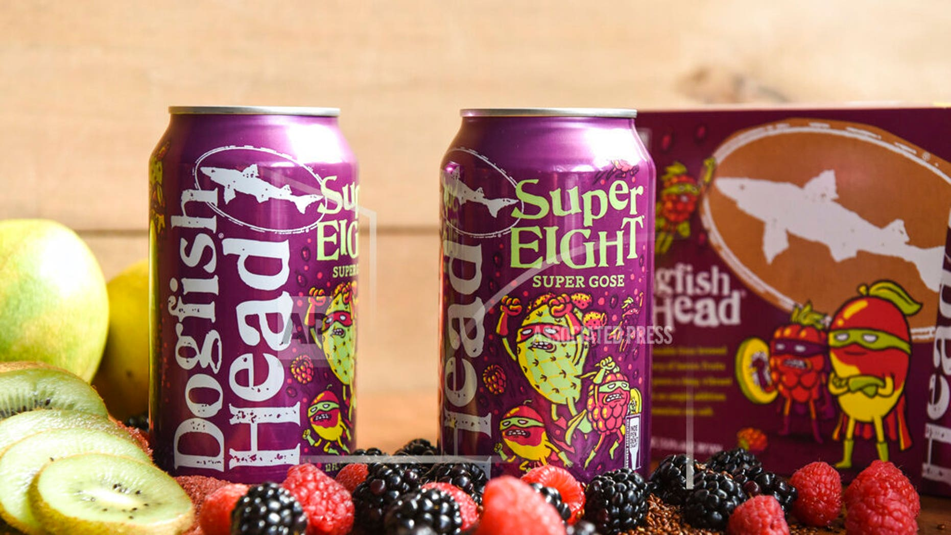 In this undated photo of Dogfish Head Craft Brewery, cans of Superfish beer from Dogfish are displayed on a table in Milton, Del. The new beer coming onto the market can be used for the development of its Super 8 film. Delaware's Dogfish Head Craft Brewery created their SuperEIGHT beer following a conversation with the people of Kodak, the renowned New York-based technology company famed for its photographic roots. (Dogfish Head Craft Brewery on AP)