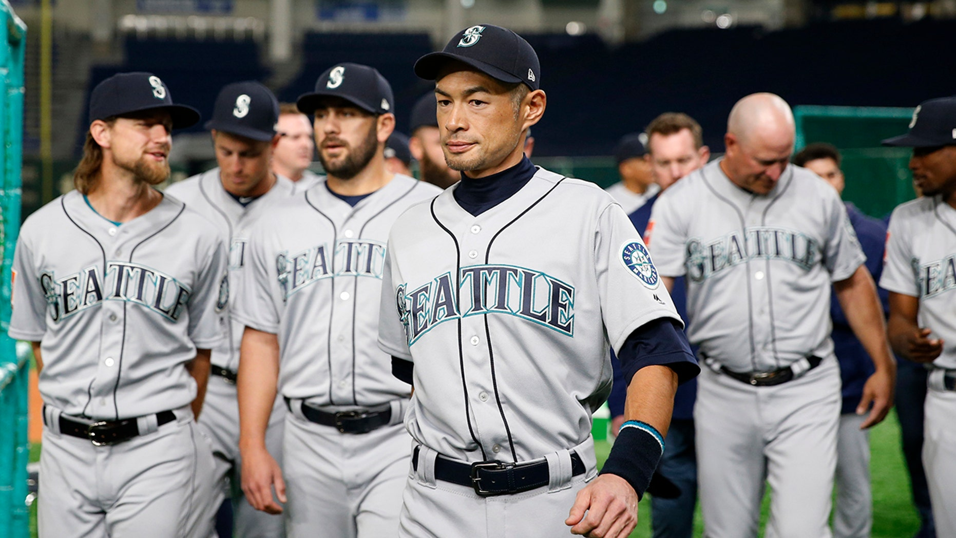 Seattle Mariners right fielder Ichiro Suzuki leaves after his team's organisation print before to Game 1 of a Major League opening array ball diversion opposite a Oakland Athletics during Tokyo Dome in Tokyo, Wednesday, Mar 20, 2019.