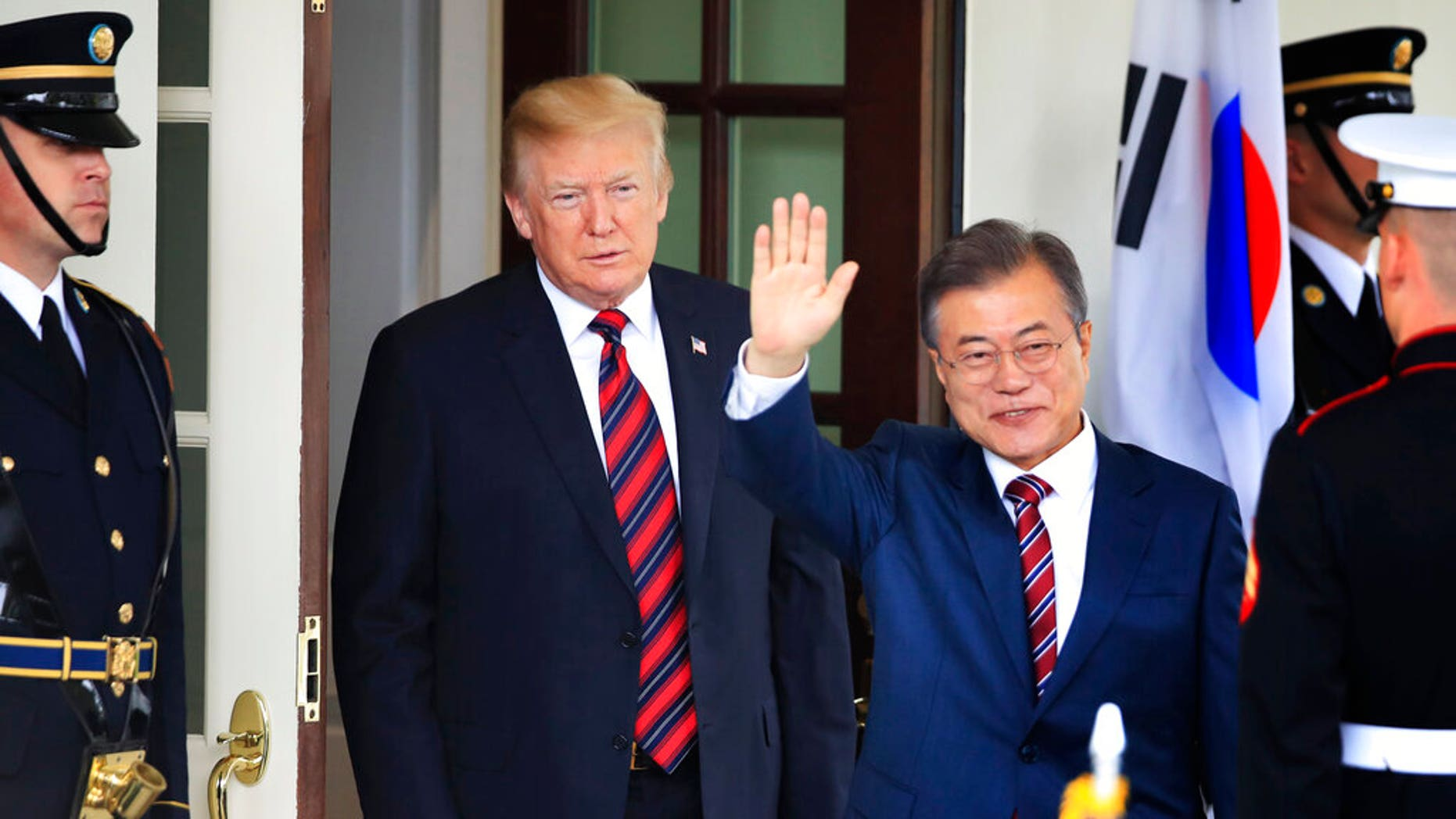 FILE South Korean President Moon Jae-in waves as he is welcomed by U.S. President Donald Trump to the White House in Washington
