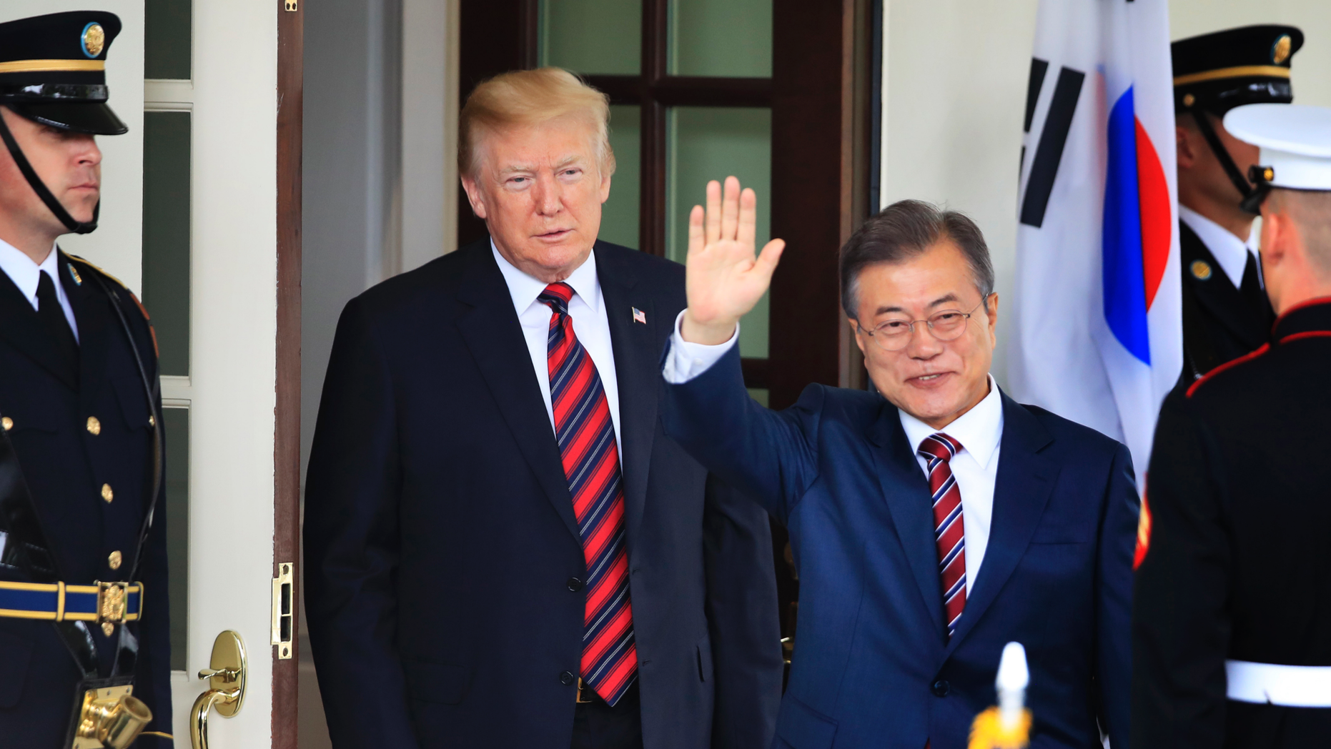 FILE - In this May 22, 2018, file photo, South Korean President Moon Jae-in waves as he is welcomed by U.S. President Donald Trump to the White House in Washington. South Korea said on Friday, March 29, 2019, Moon will travel to the United States on April 10-11 to meet with Trump for a summit on North Korean nuclear diplomacy. (AP Photo/Manuel Balce Ceneta, File)