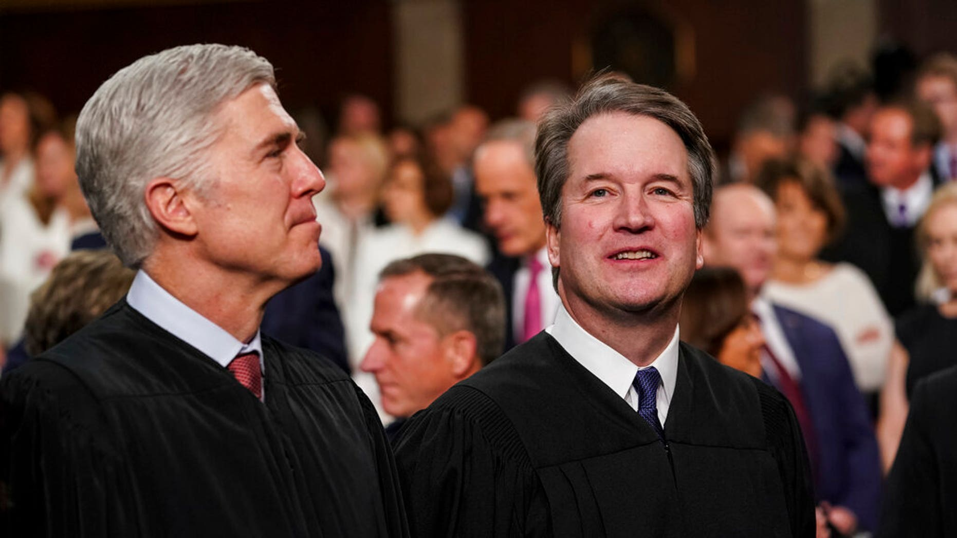 Supreme Court judges Neil Gorsuch, left, and Brett Kavanaugh watch as President Trump arrives to deliver his speech on the state of union ahead of a joint session of Congress at the Capitol in Washington. (Associated Press)