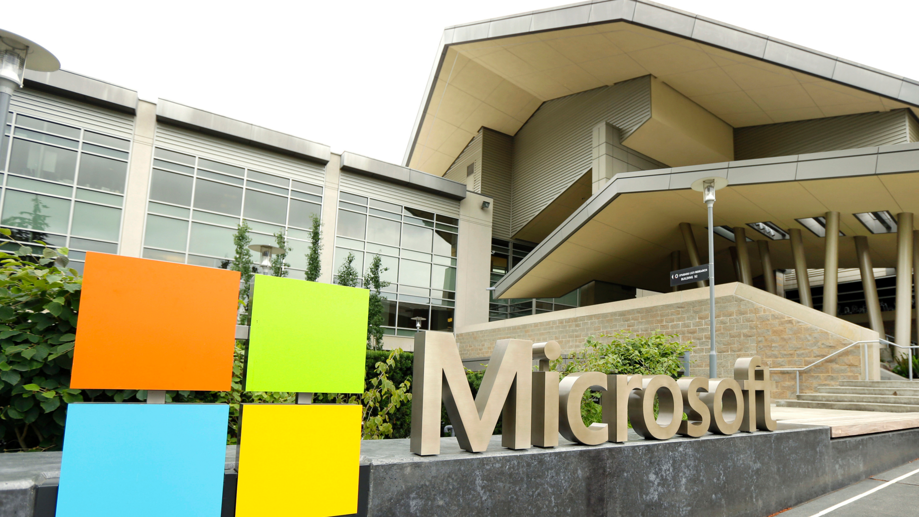 FILE - This July 3, 2014 file photo shows Microsoft Corp. signage outside the Microsoft Visitor Center in Redmond, Wash. (AP Photo Ted S. Warren, File)