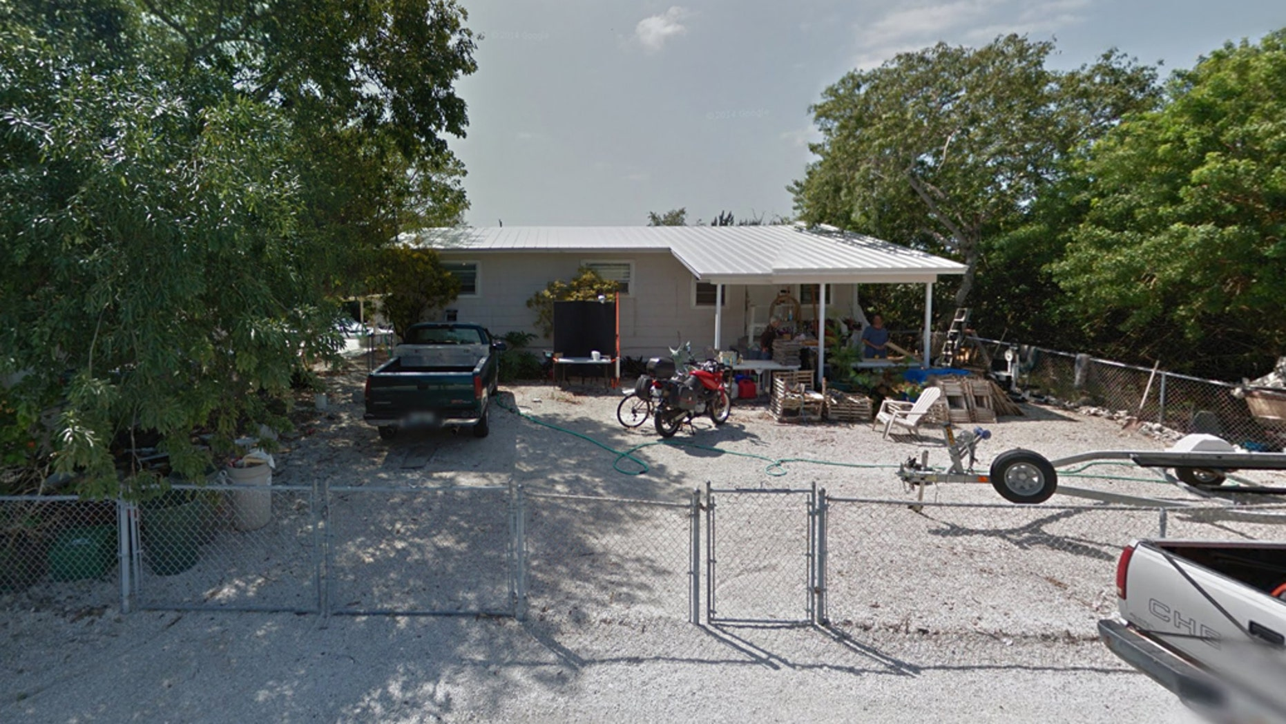 Sheriff's officials say a Florida man was killed when the car he was working on fell on top of him. (Google Street View)