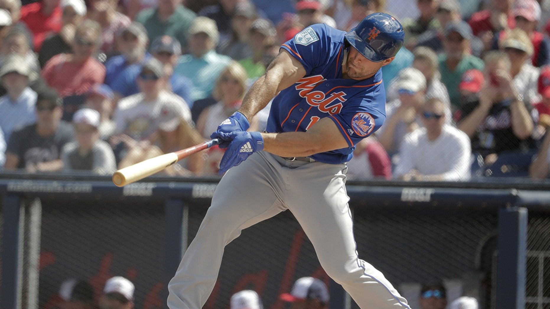 Tim Tebow bats in the first inning during an exhibition spring training baseball game against the Washington Nationals on March 7.