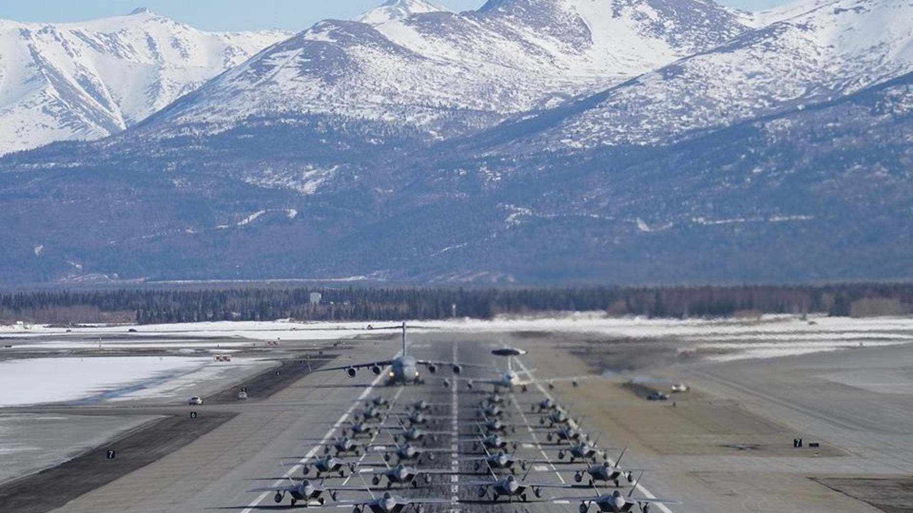 "A squadron of Air Force jets participating in an ""elephant walk."""