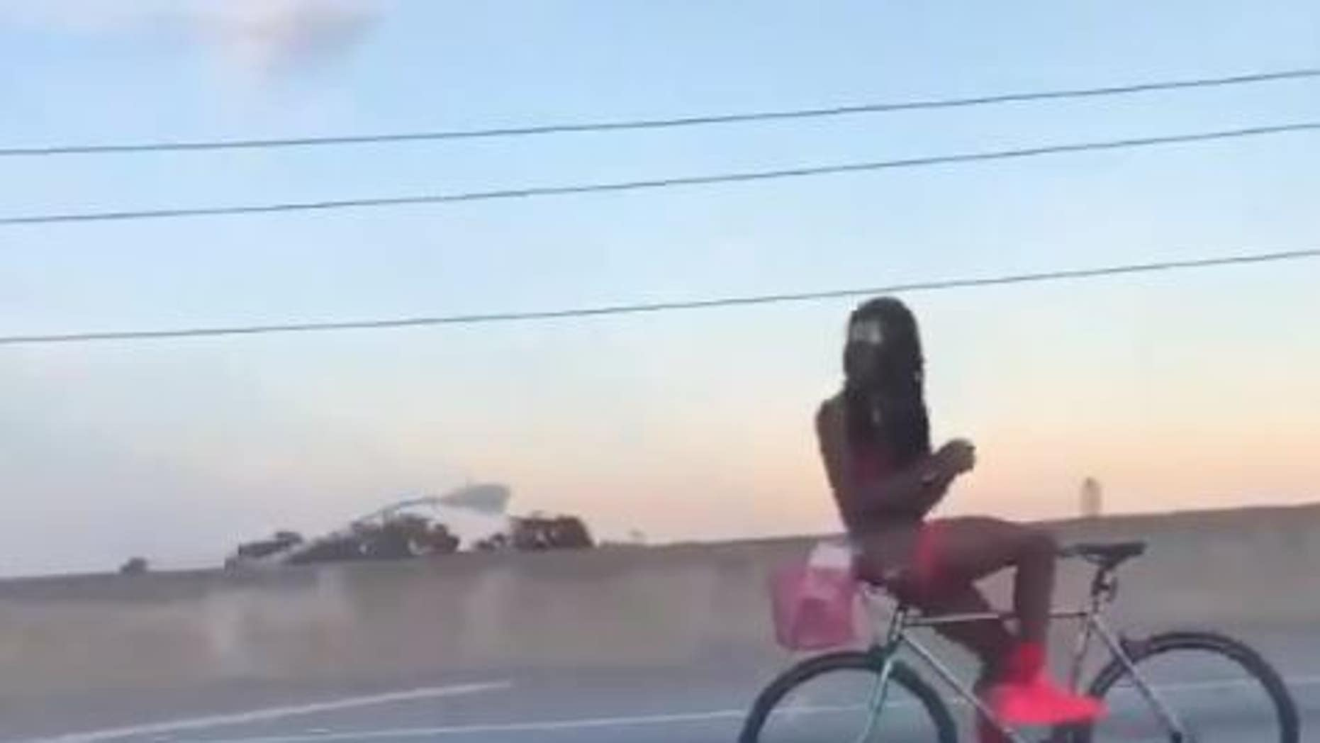 A viral video captured a man riding backwards on I-95 in Florida on Sunday while appearing to be semi-nude.