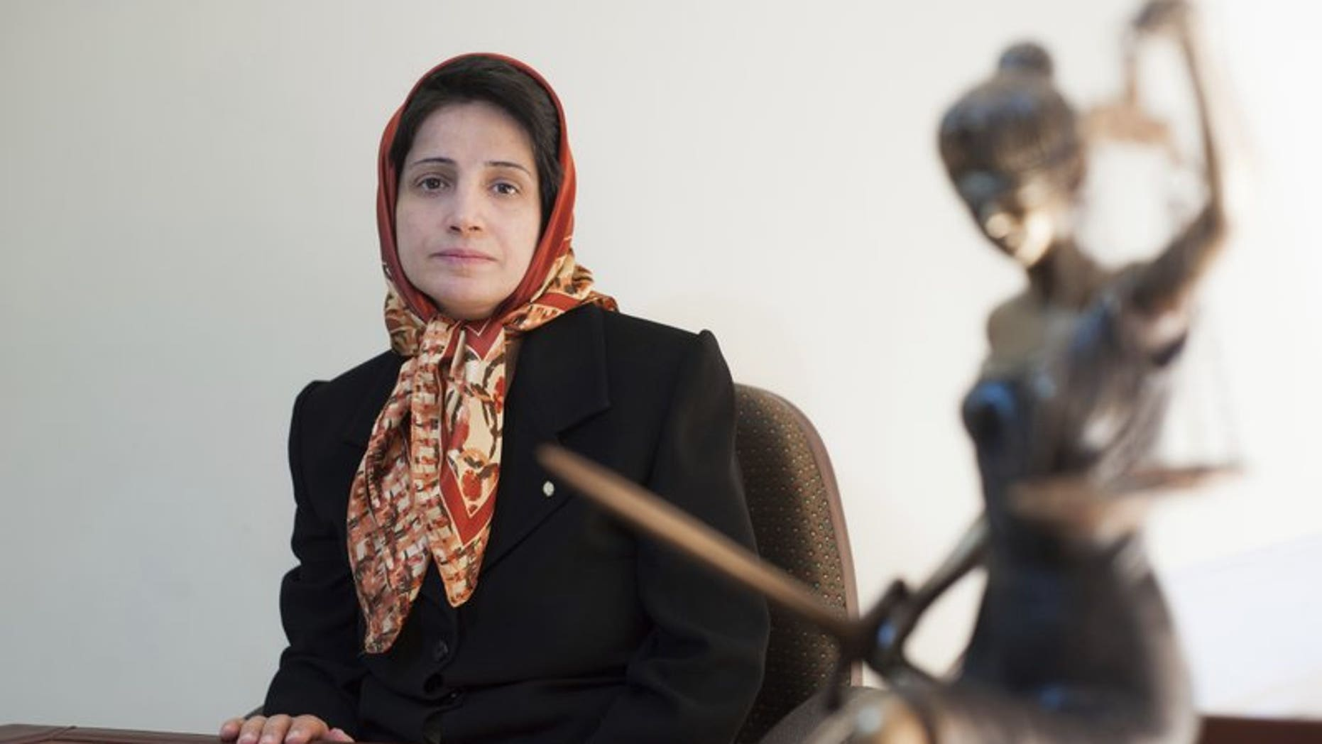 In this Nov. 1, 2008 photo, Iranian human rights lawyer Nasrin Sotoudeh, poses for a photograph in her office in Tehran, Iran. On Wednesday, March 6, 2019, the New York-based Center for Human Rights in Iran, said Sotoudeh, a prominent human rights lawyer in Iran who defended women protesting against the Islamic Republic's mandatory headscarf, has been convicted and faces years in prison.