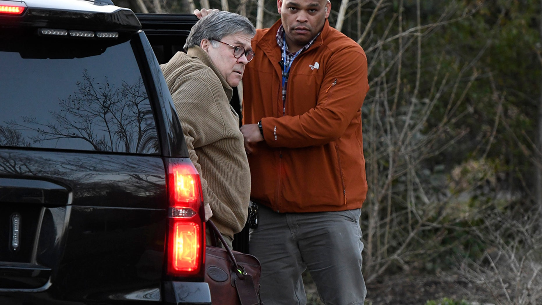 U.S. Attorney General William Barr, left, arrives at his home in McLean, Va., on Saturday evening, March 23, 2019. Barr will decide how much of Special Counsel Robert Mueller's Russia investigation report will be released to Congress and the public. (Associated Press)