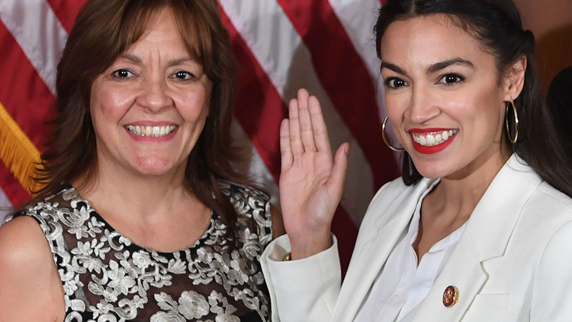 ​ Bianca Ocasio-Cortez and US House Representative Alexandria Ocasio-Cortez (Photo credit should read SAUL LOEB/AFP/Getty Images)