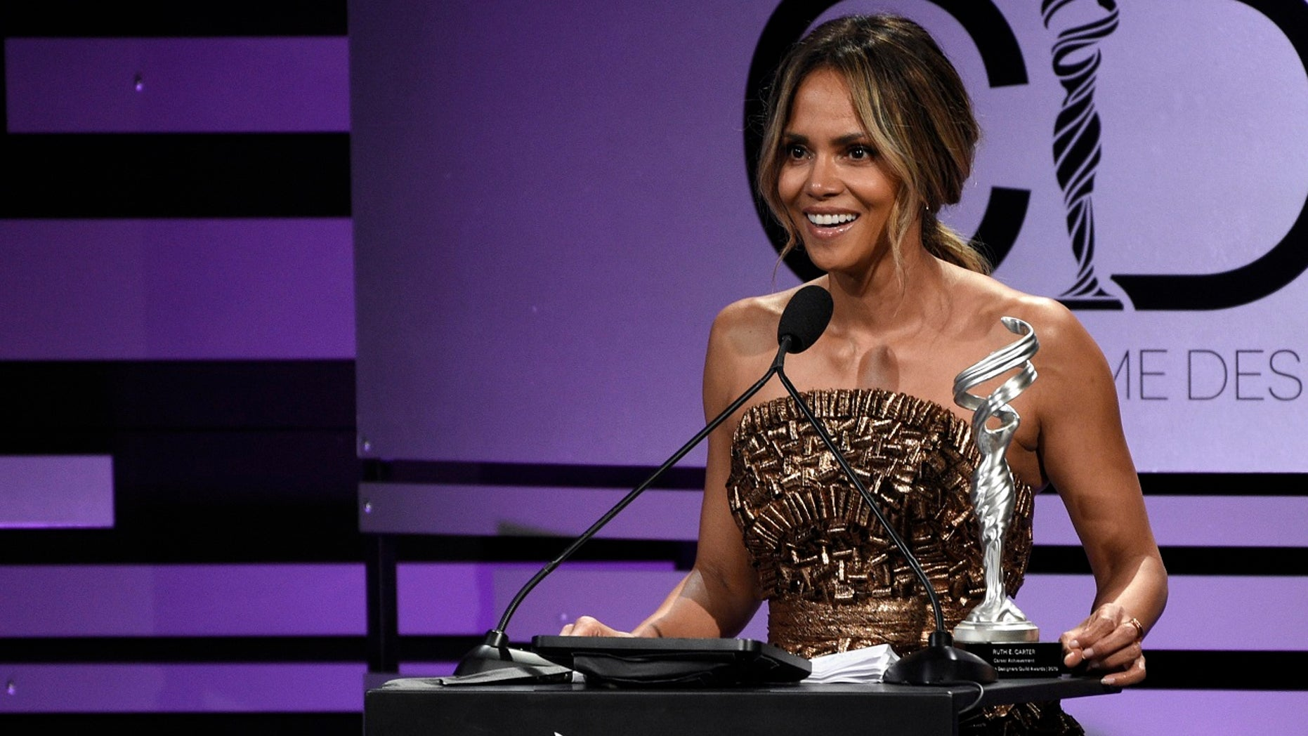 Halle Berry presents the career achievement award at the 21st annual Costume Designers Guild Awards at The Beverly Hilton Hotel on Tuesday, Feb. 19, 2019, in Beverly Hills, Calif.