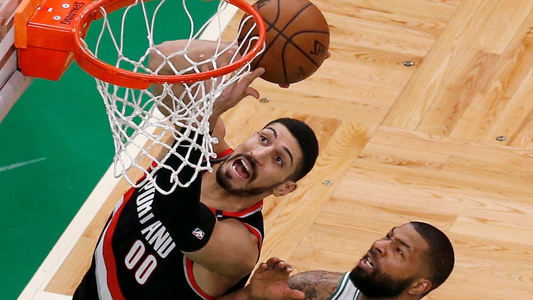 Portland Trail Blazers center Enes Kanter, left, drives to the basket against Boston Celtics forward Marcus Morris during an NBA basketball game, Feb. 27, 2019, in Boston. (Associated Press)