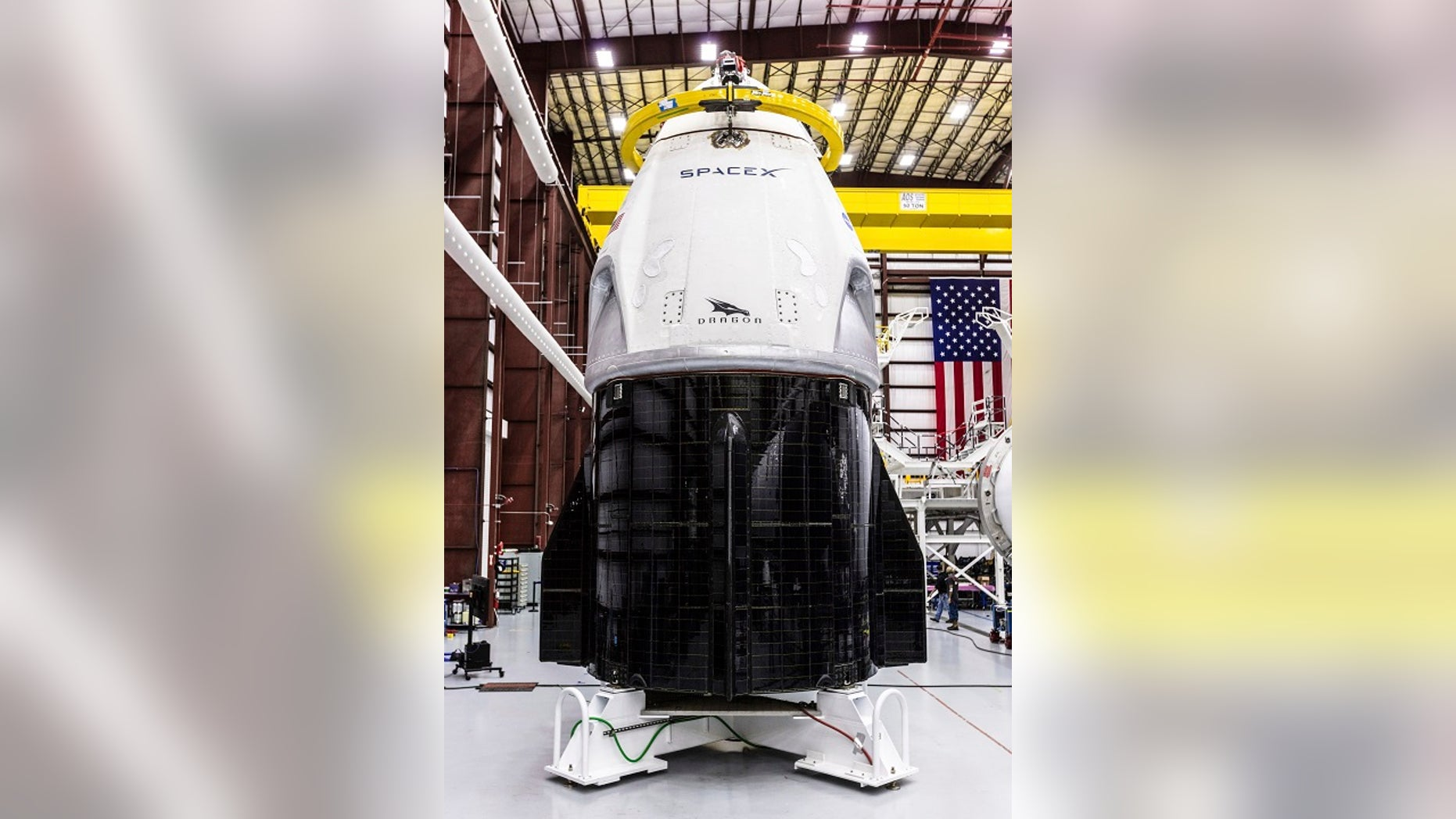 SpaceX's Crew Dragon spacecraft and Falcon 9 rocket are positioned inside the company's hangar at Launch Complex 39A at NASA's Kennedy Space Center in Florida. (Space X via AP)