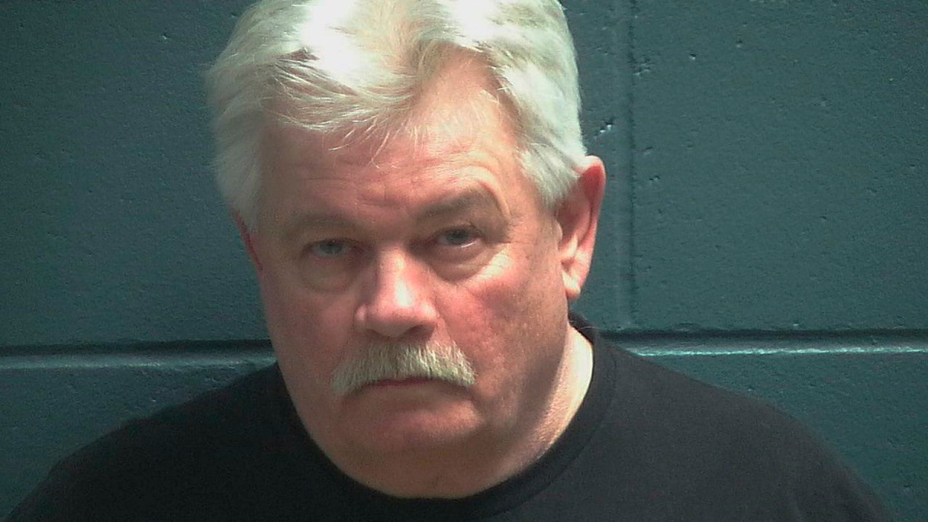 Douglas Kluth is facing at least his 10th drunken driving charge. Authorities allege he had an open beer on the center console of his car. (Oconto County Jail via AP)