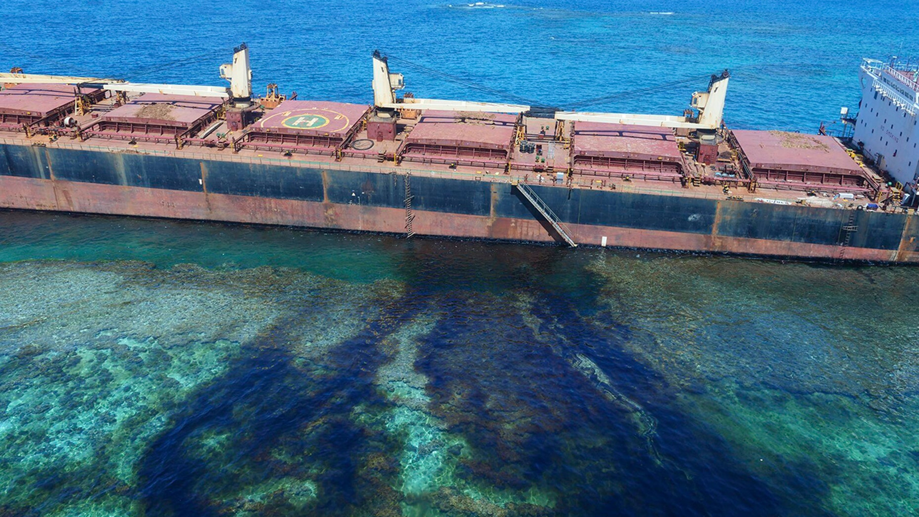 """In this Feb. 26, 2019, photo taken by the Australian Maritime Safety Authority near Rennell Island in the Solomon Islands shows the """"MV Solomon Trader"""" ship which ran aground Feb. 5."""