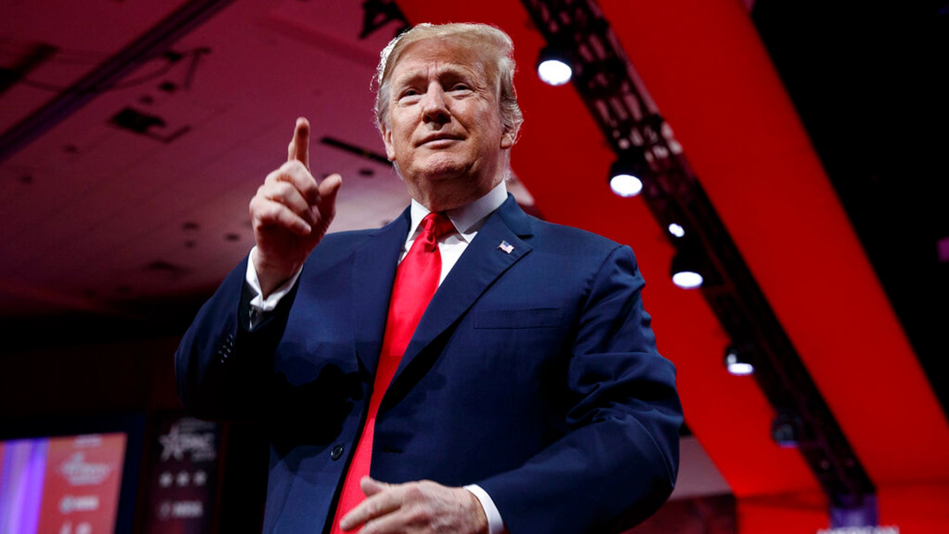 President Donald Trump looks to the cheering audience as he arrives to speak at Conservative Political Action Conference, CPAC 2019, in Oxon Hill, Md., Saturday, March 2, 2019.