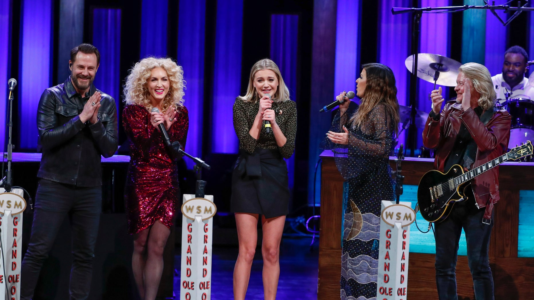 Kelsea Ballerini, center, is invited to join the Opry by members of Little Big Town at the Grand Ole Opry on Tuesday, March 5, 2019, in Nashville, Tenn.