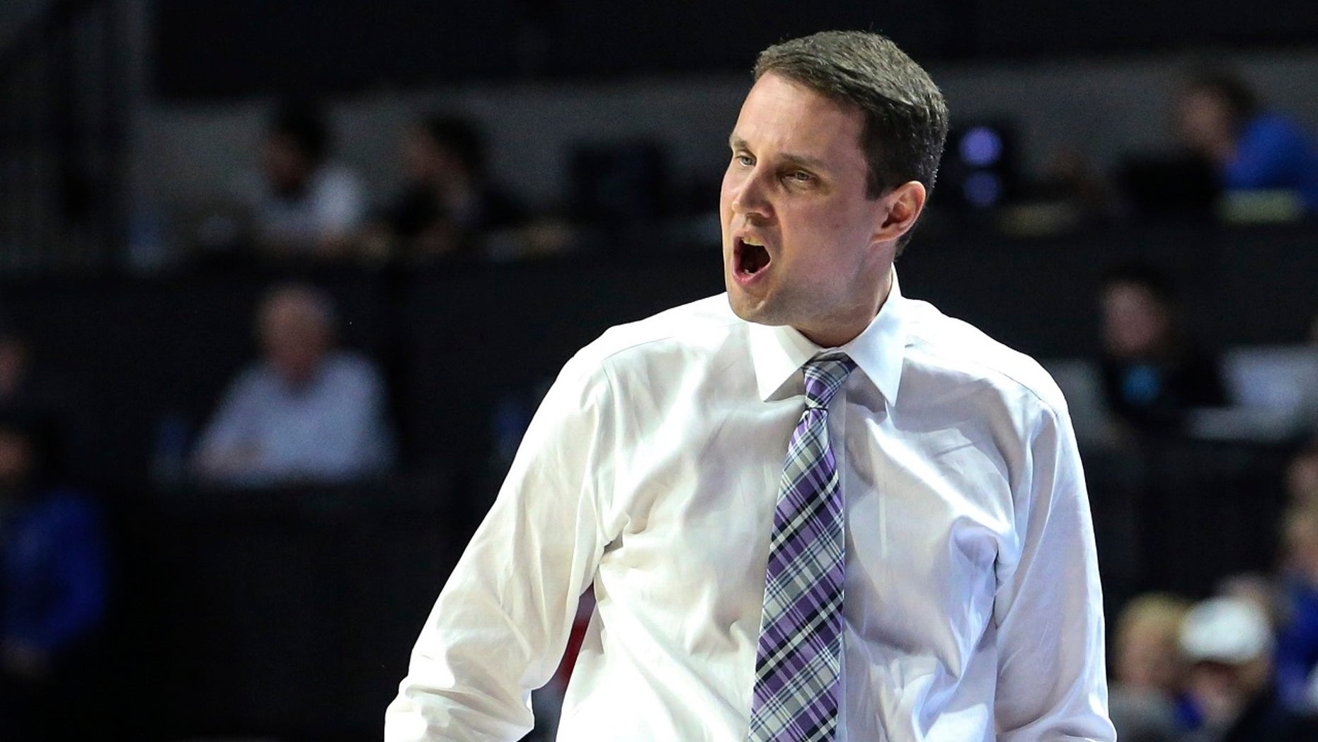 LSU coach Will Wade shouts during the first half of the team's NCAA college basketball game against Florida in Gainesville, Fla., Wednesday, March 6, 2019.