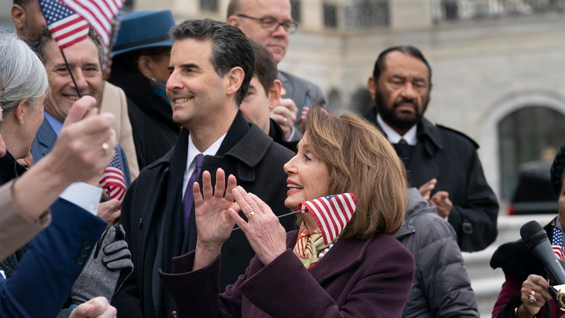 """House Speaker Nancy Pelosi, D-Calif., and other House Democrats rally ahead of the passage of H.R. 1, """"The For the People Act,"""" at the Capitol in Washington, Friday, March 8, 2019. (Associated Press)"""