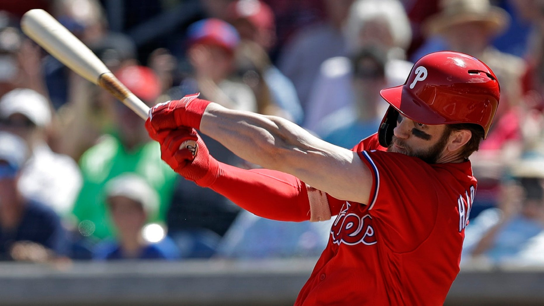 Philadelphia Phillies' Bryce Harper swings at a pitch from Toronto Blue Jays' Matt Shoemaker during the first inning of a spring training baseball game Saturday, March 9, 2019, in Clearwater, Fla. (Associated Press)