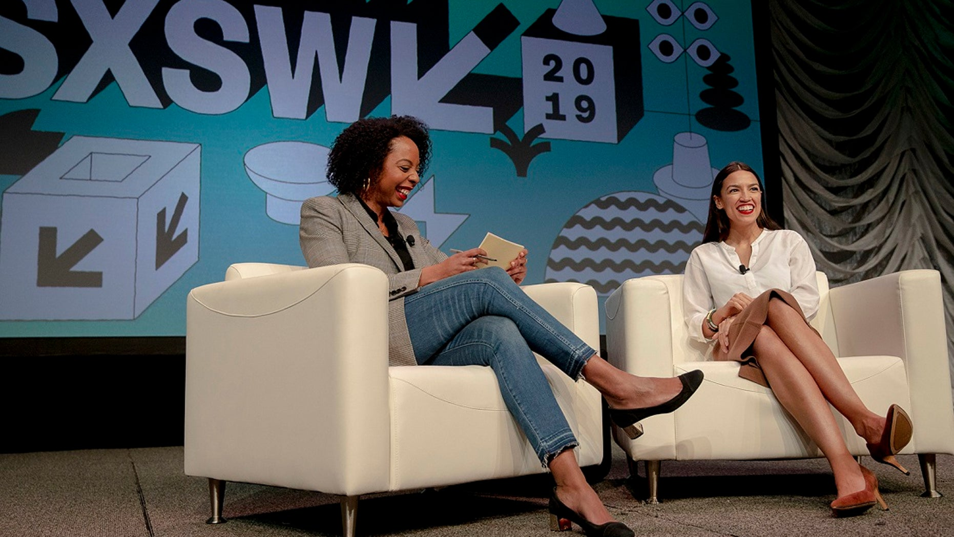 Rep. Alexandria Ocasio-Cortez, right, D-New York, speaks with Briahna Gray, a senior politics editor at The Intercept, during South by Southwest on Saturday, March 9, 2019, in Austin, Texas. (Nick Wagner/Austin American-Statesman via AP)