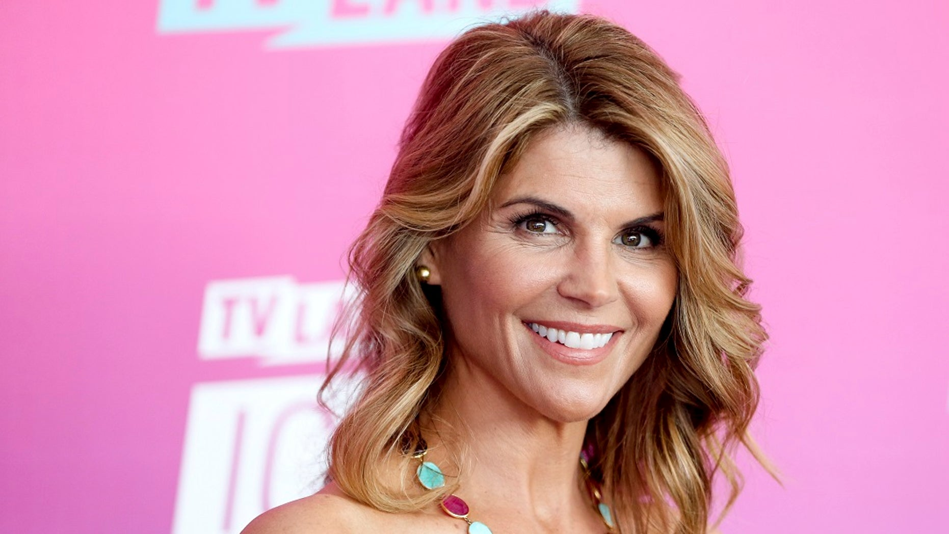 FILE - Actress Lori Loughlin arrives at the TV Land Icon Awards in Santa Monica, Calif., in an undated photo. (Photo by Rich Fury/Invision/AP, File)