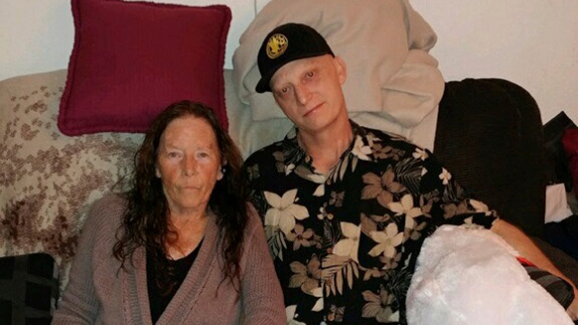 Michael R. White, right, is seen with his mother, Joanne White, in 2018. White, a U.S. Navy veteran from California, has been sentenced to 10 years in prison in Iran, his lawyer said Saturday, March 16, 2019. (White family via Associated Press)