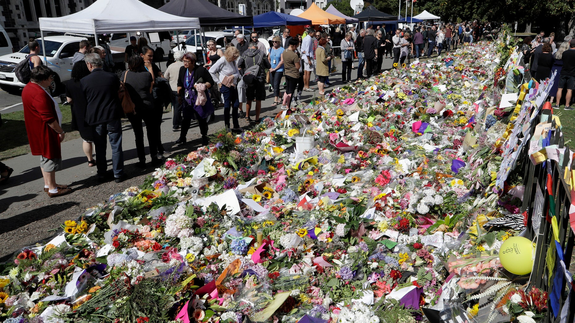 A man who once visited the rifle club where the New Zealand mass shooting suspect attended says he warned police about the shocking and extremist views of members there years ago, but nothing was done. Pictured is a memorial to the victims of Friday's shooting in Christchurch