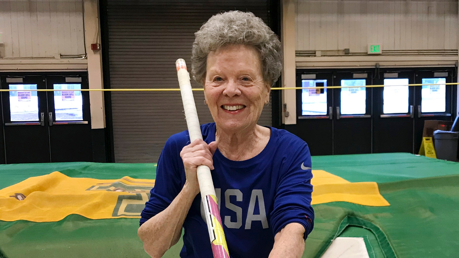 """In this Thursday, March 13, 2019 photo, Florence """"Flo"""" Filion Meiler, an 84-year-old record-setting pole vaulter, poses while training at the University of Vermont indoor track in Burlington, Vt. Meiler is headed to the world championships in Poland."""