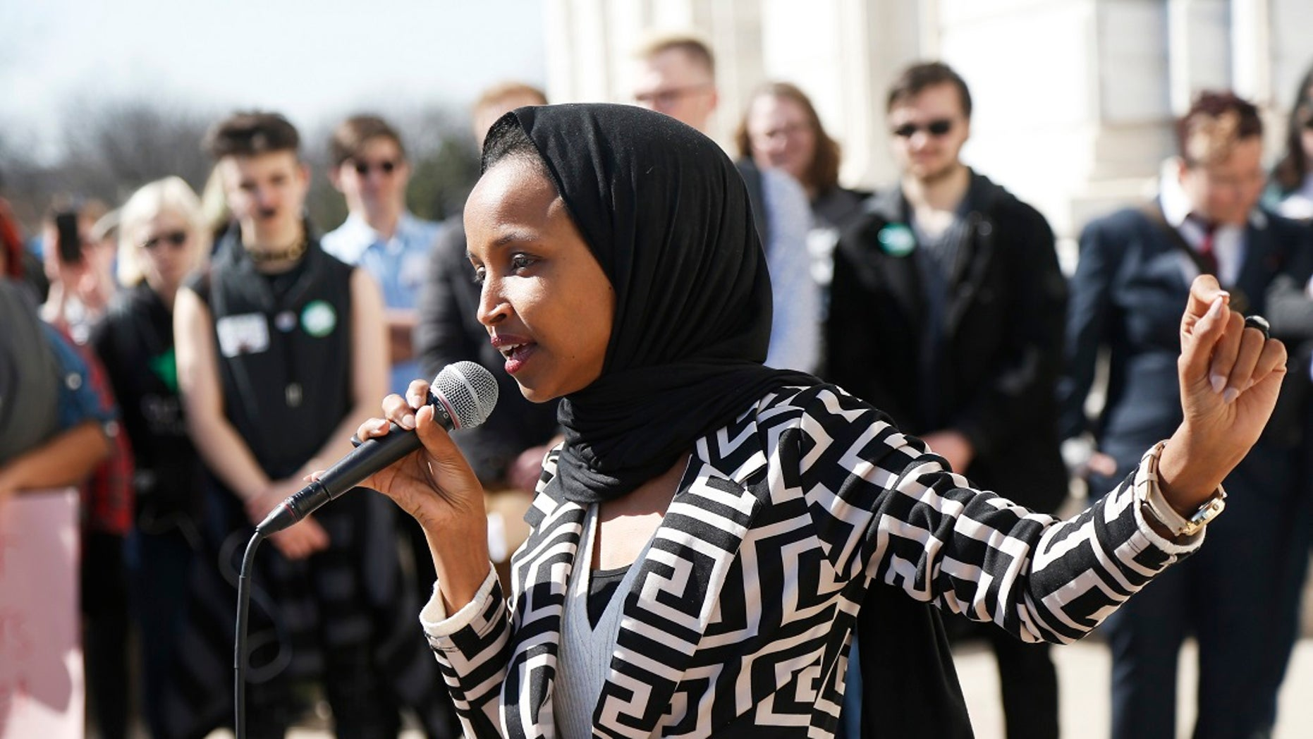U.S. Rep Ilhan Omar, D-Minn., speaks to support LGBTQ and allied high school students from across the state of Minnesota outside the State Capitol in St. Paul, March 21, 2019. (Associated Press)
