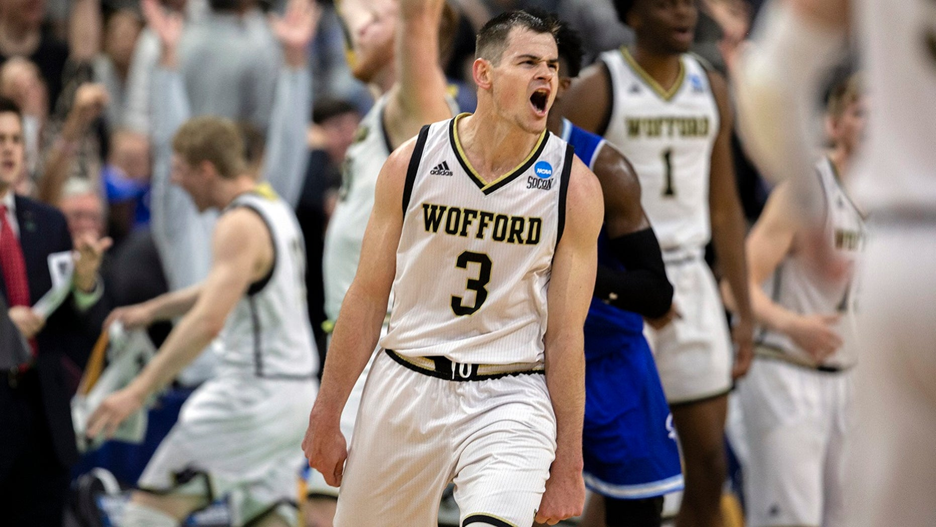 Wofford guard Fletcher Magee (3) celebrates with teammates after hitting a 3-point basket during the final moments of the second half against Seton Hall in a first-round game in the NCAA men's college basketball tournament in Jacksonville, Fla. Thursday, March 21, 2019.