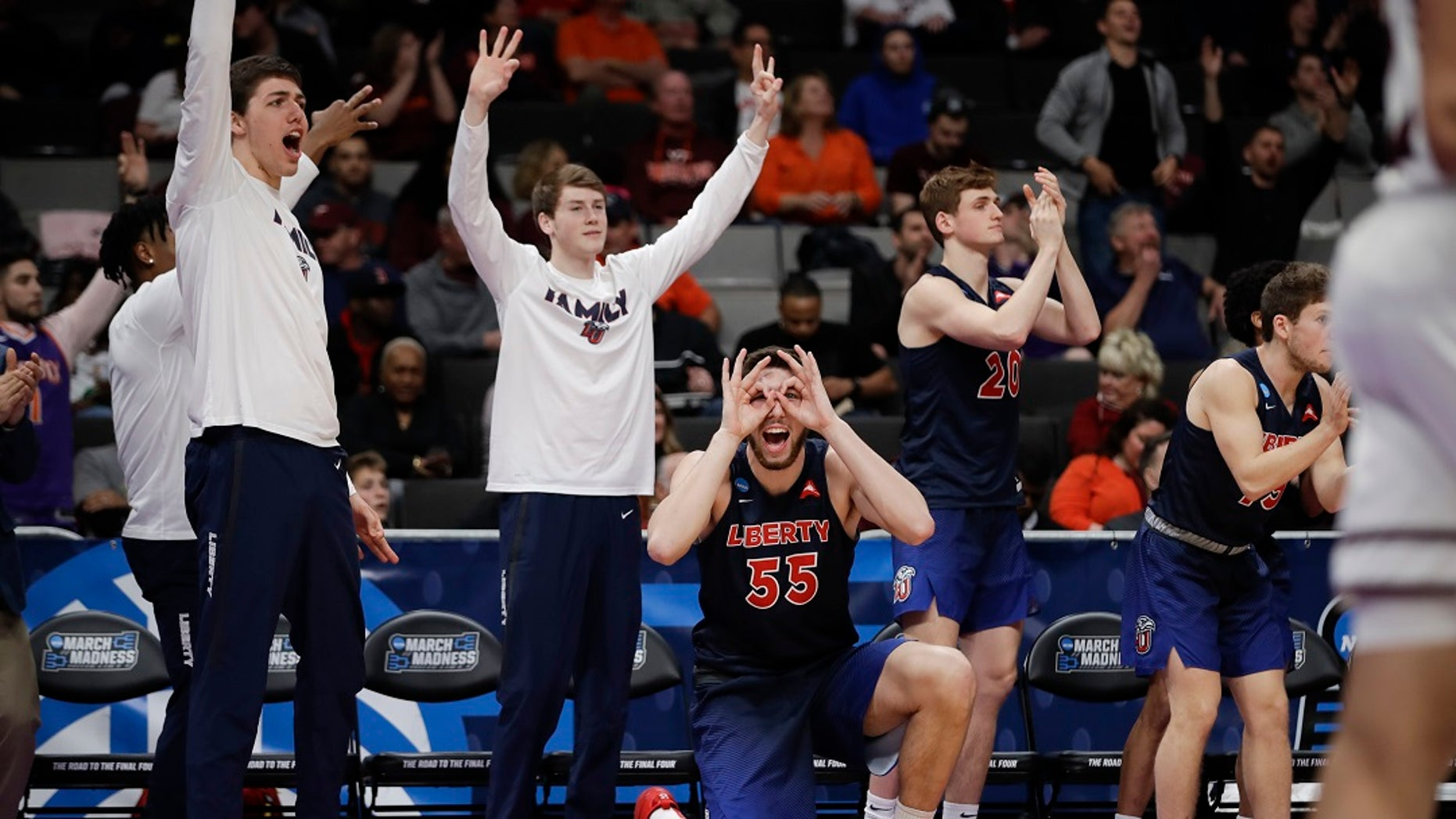 Liberty players celebrate during the second half against Mississippi State in a first-round game in the NCAA men's college basketball tournament Friday, March 22, 2019, in San Jose, Calif. (Associated Press)