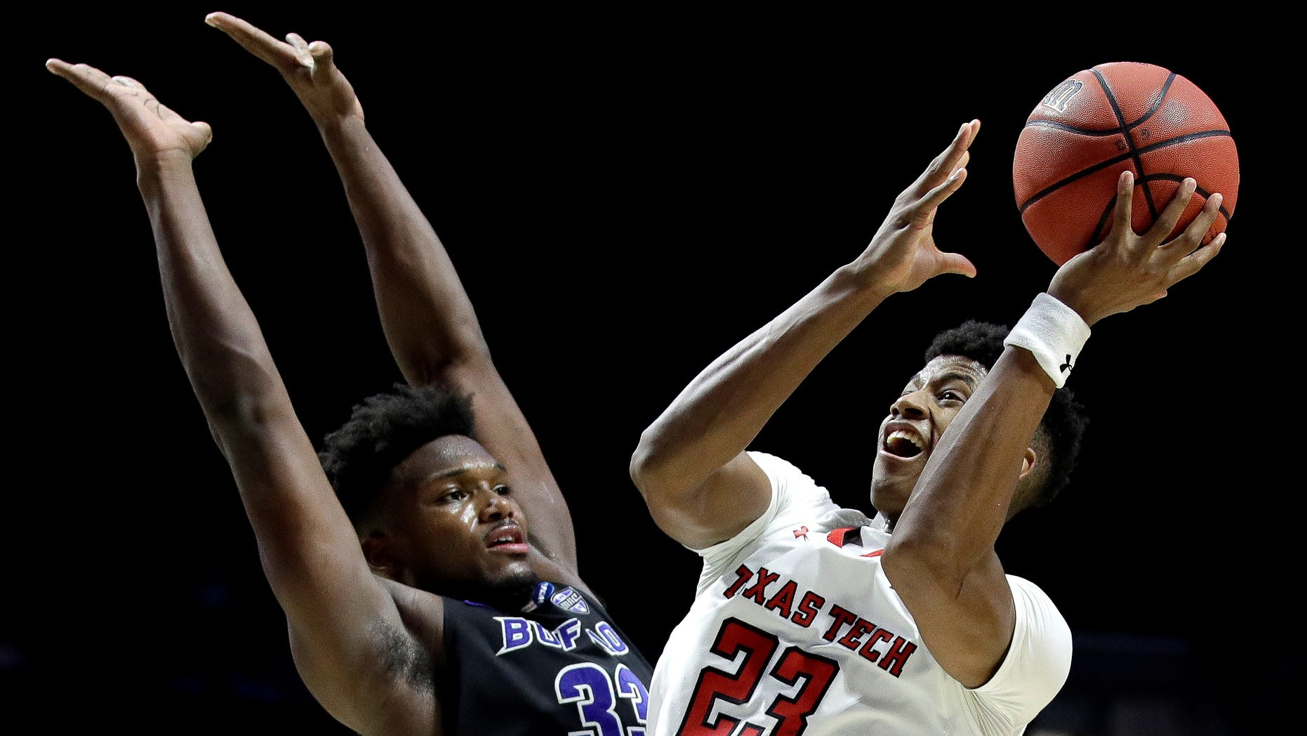 Texas Tech's Jarrett Culver (23) shoots past Buffalo's Nick Perkins (33) during the second half of a second-round men's college basketball game in the NCAA Tournament.