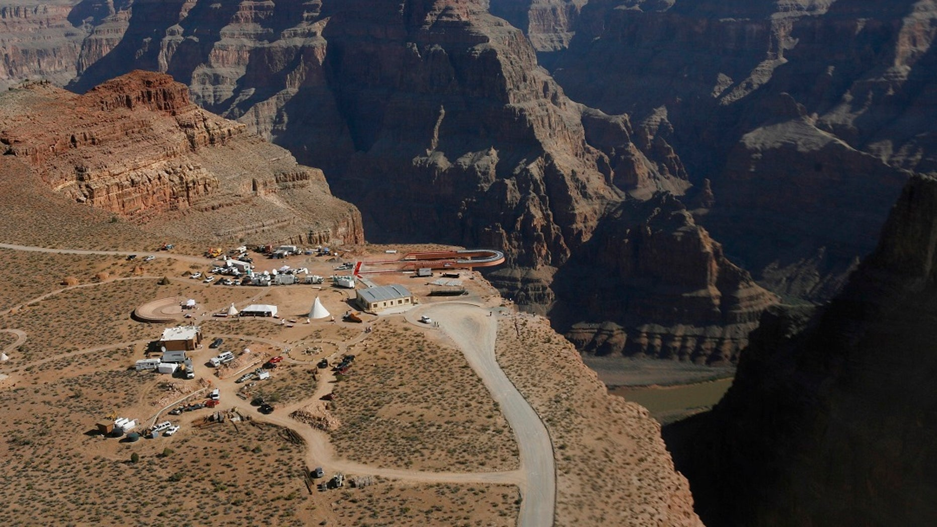 Skywalk hangs over the Grand Canyon at Hualapai Indian Reservation before its grand opening ceremony at Grand Canyon West, Ariz. Crews are looking for a tourist who slipped and fell over the edge of a Grand Canyon looking into tribal land. (AP Photo / Ross D. Franklin, File)