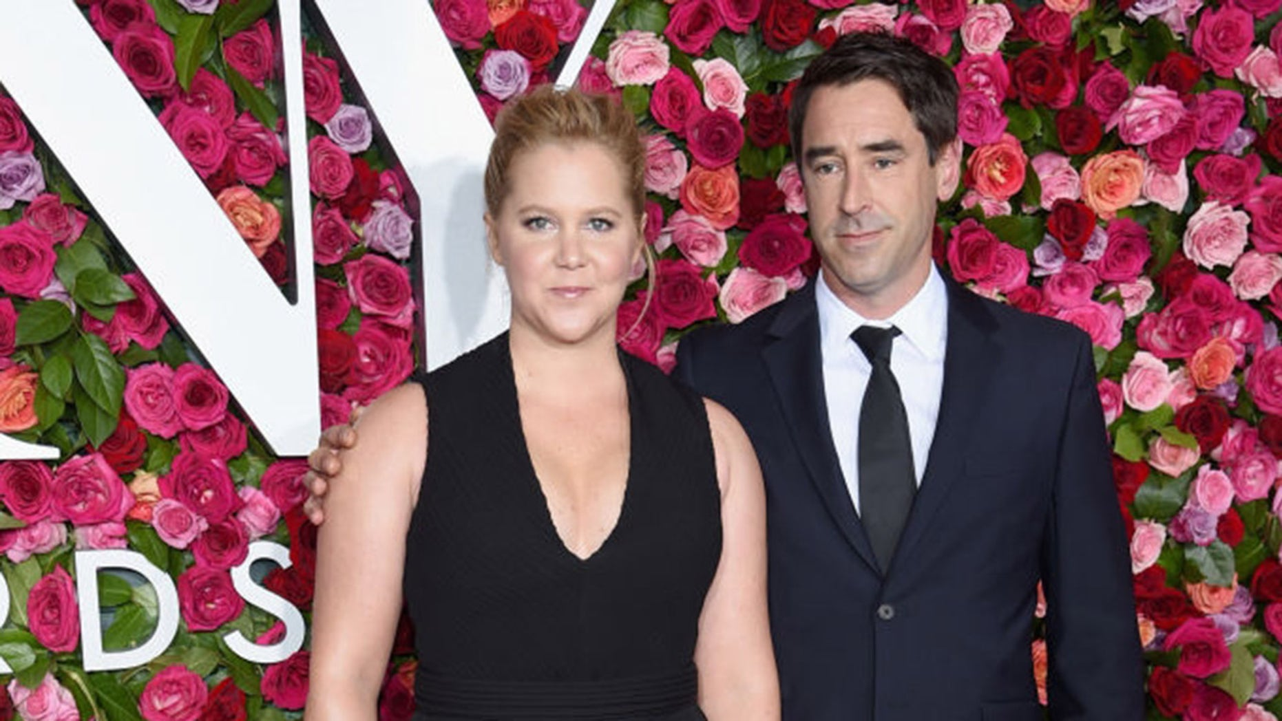 Amy Schumer (L) and Chris Fischer attend the 72nd Annual Tony Awards at Radio City Music Hall on June 10, 2018 in New York City.