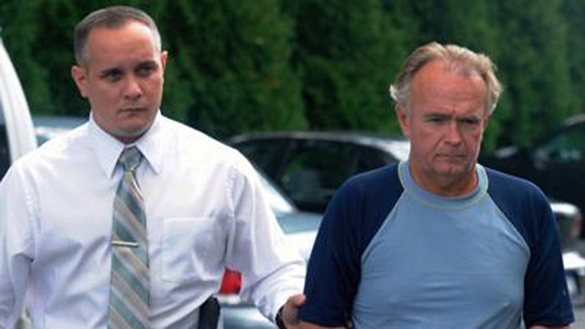 The Rev. Arthur Burton Schirmer, 62, right, is led into district court by Pennsylvania State Trooper Bill Skotleski in Tannersville, Pa., in this Sept. 13, 2010 file photo. The retired Pennsylvania pastor was ordered Tuesday, Sept. 28, 2010 to stand trial on charges he killed his wife and staged a car accident to cover it up, a case that has investigators re-examining his first wife's death. (AP Photo/Pocono Record, David Kidwell)