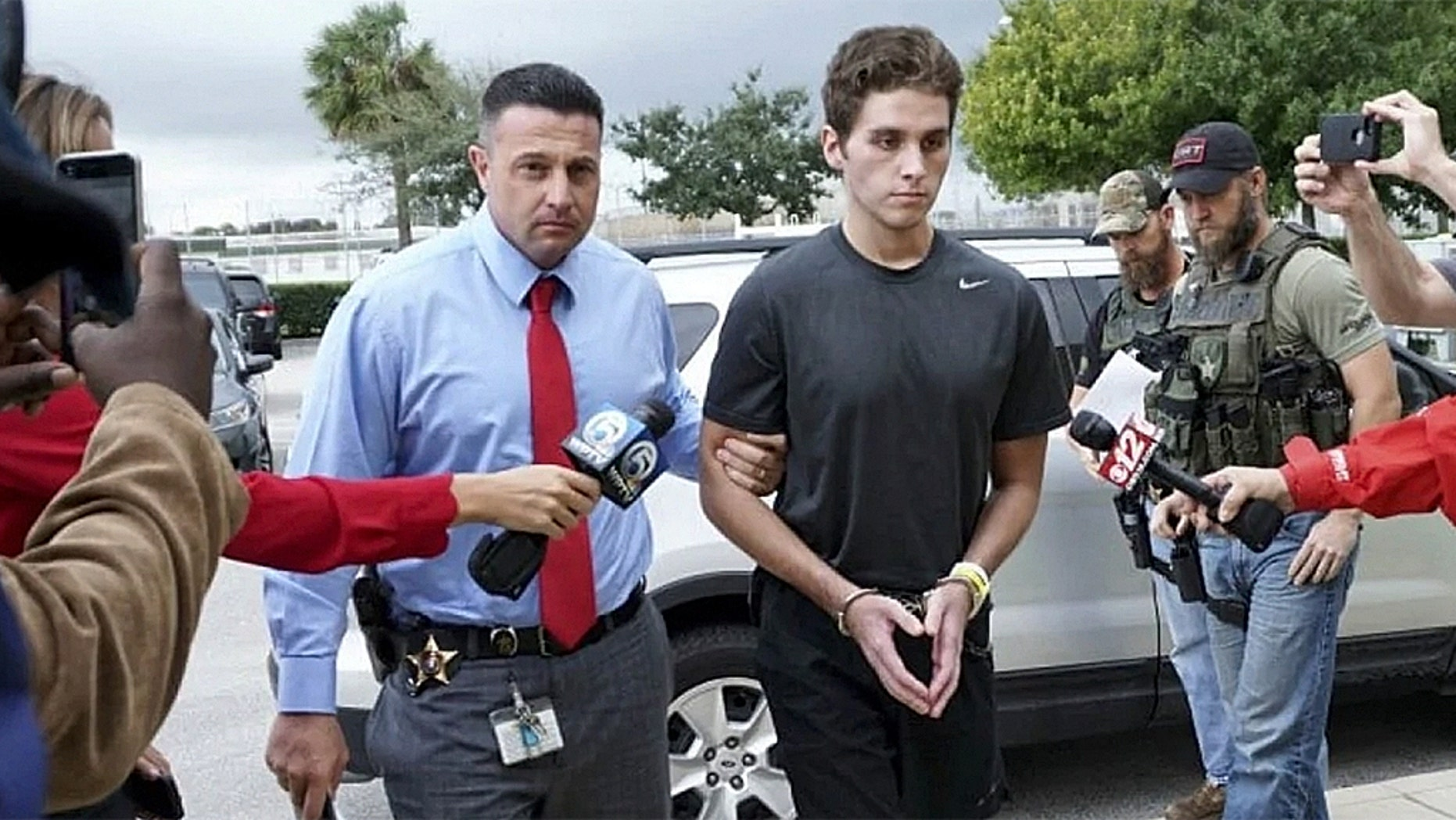 Austin Harrouff is transported by detectives to the Martin County jail from St. Mary's Hospital in Stuart, Fla.