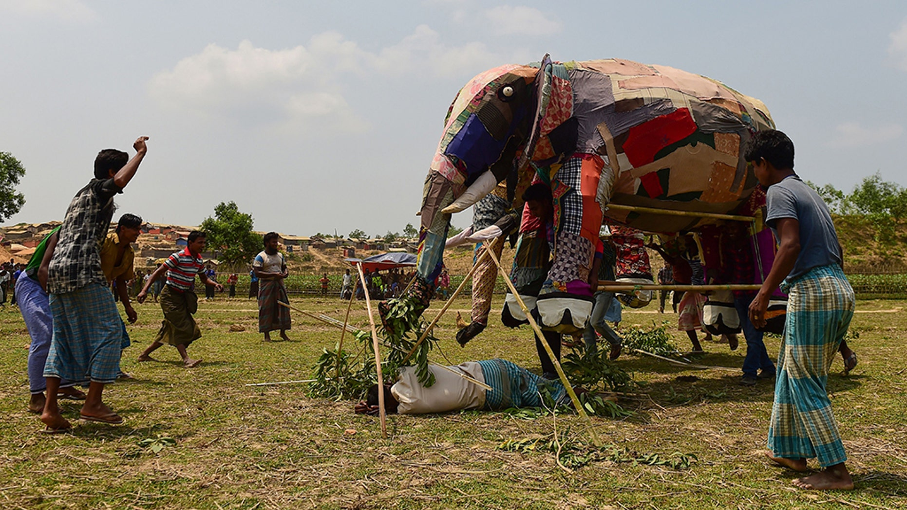 This photo taken on April 7, 2018 shows Rohingya refugee attending a demonstration of elephant resistance arranged by the UNHCR and IUCN at the Kutupalong refugee camp in Ukhia. The purpose of the training day is sobering - a dozen Rohingya have been killed by wild elephants whose habitat has been consumed by Kutupalong refugee camp.