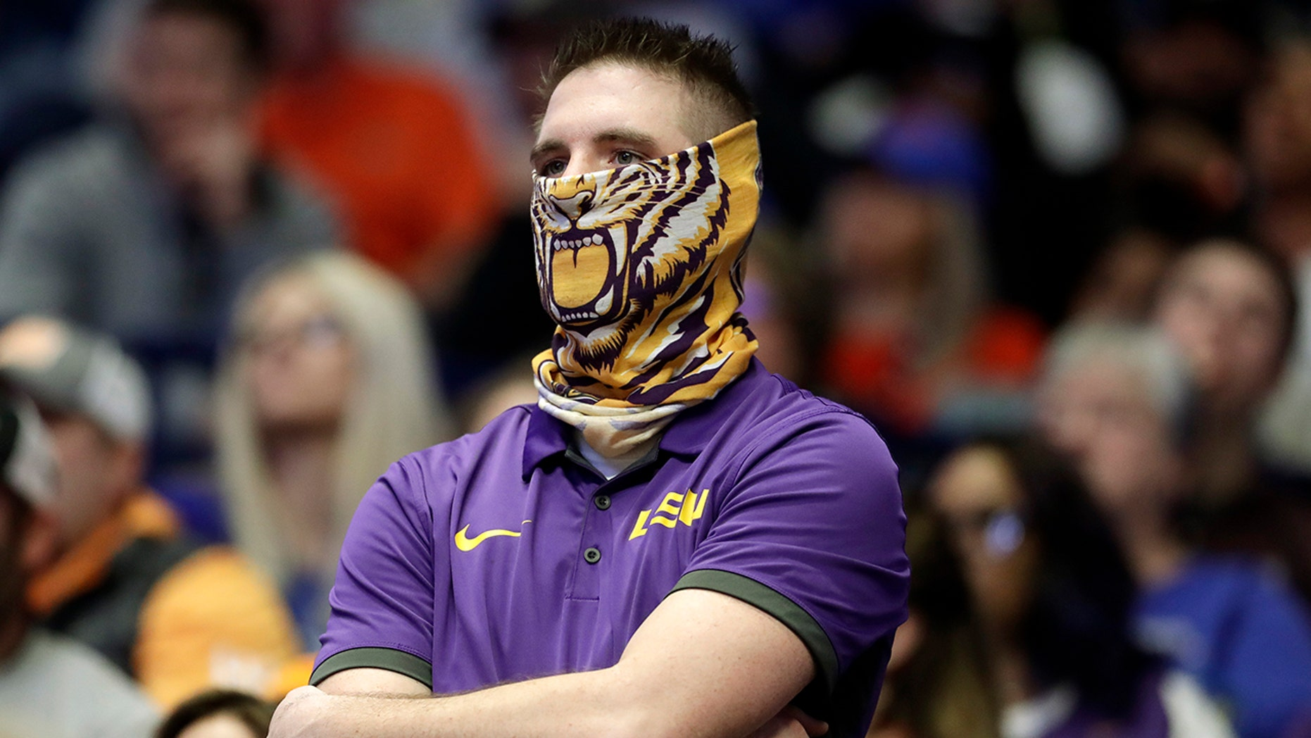 An LSU fan watches during the final minutes of LSU's loss to Florida in an NCAA college basketball game at the Southeastern Conference tournament Friday, March 15, 2019, in Nashville, Tenn. Florida won 76-73. (AP Photo/Mark Humphrey)