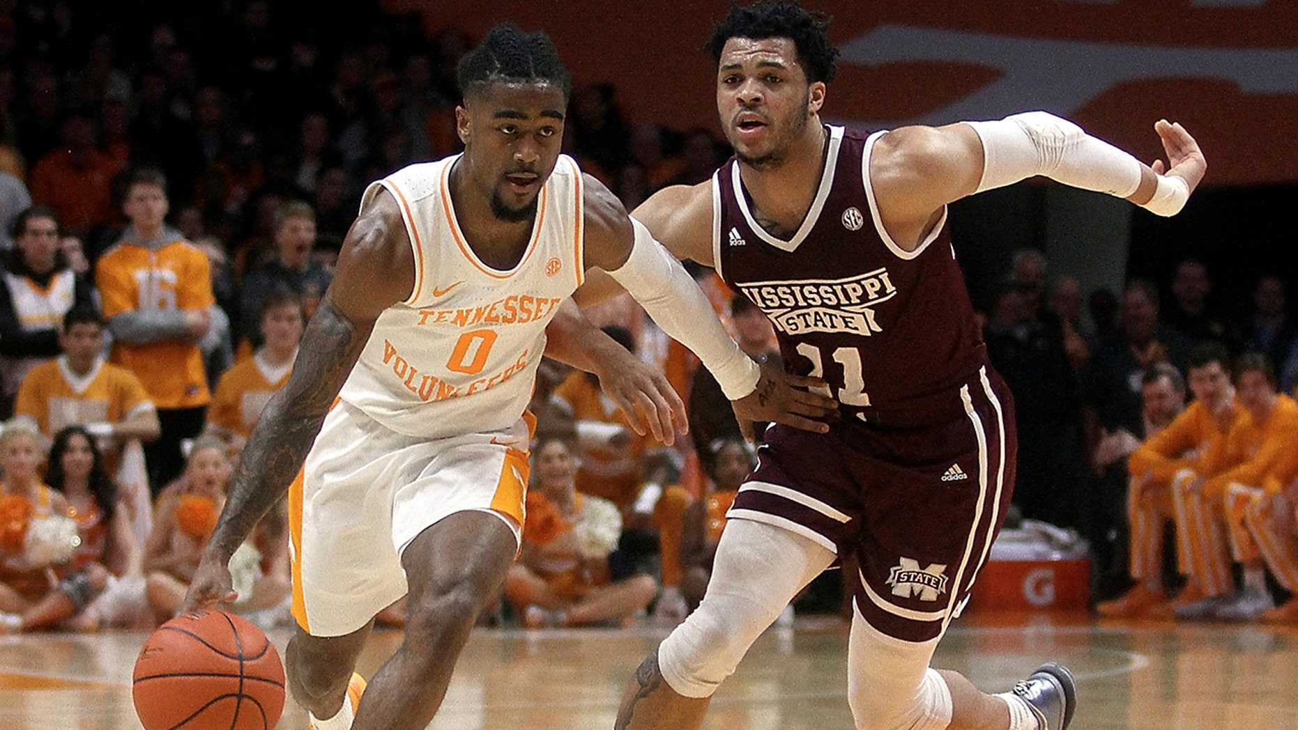 Tennessee's Jordan Bone brings the ball up while defended by Mississippi State's Quinndary Weatherspoon during an NCAA college basketball game Tuesday, March 5, 2019, in Knoxville, Tenn.