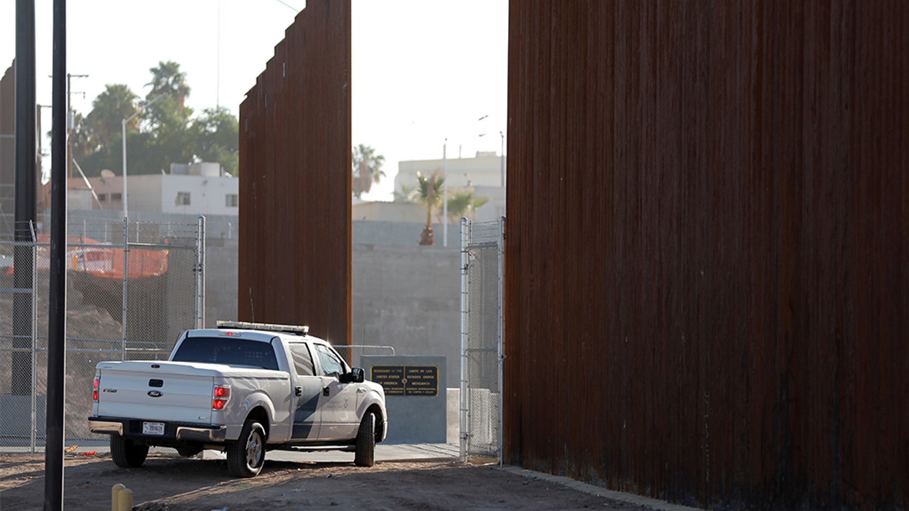 FILE - A Border Patrol vehicle guards the wall at the border prior to U.S. Department of Homeland Security Secretary Kirstjen Nielsen visit to U.S. President Trump's border wall in the El Centro Sector in Calexico, Calif.,  last year. REUTERS