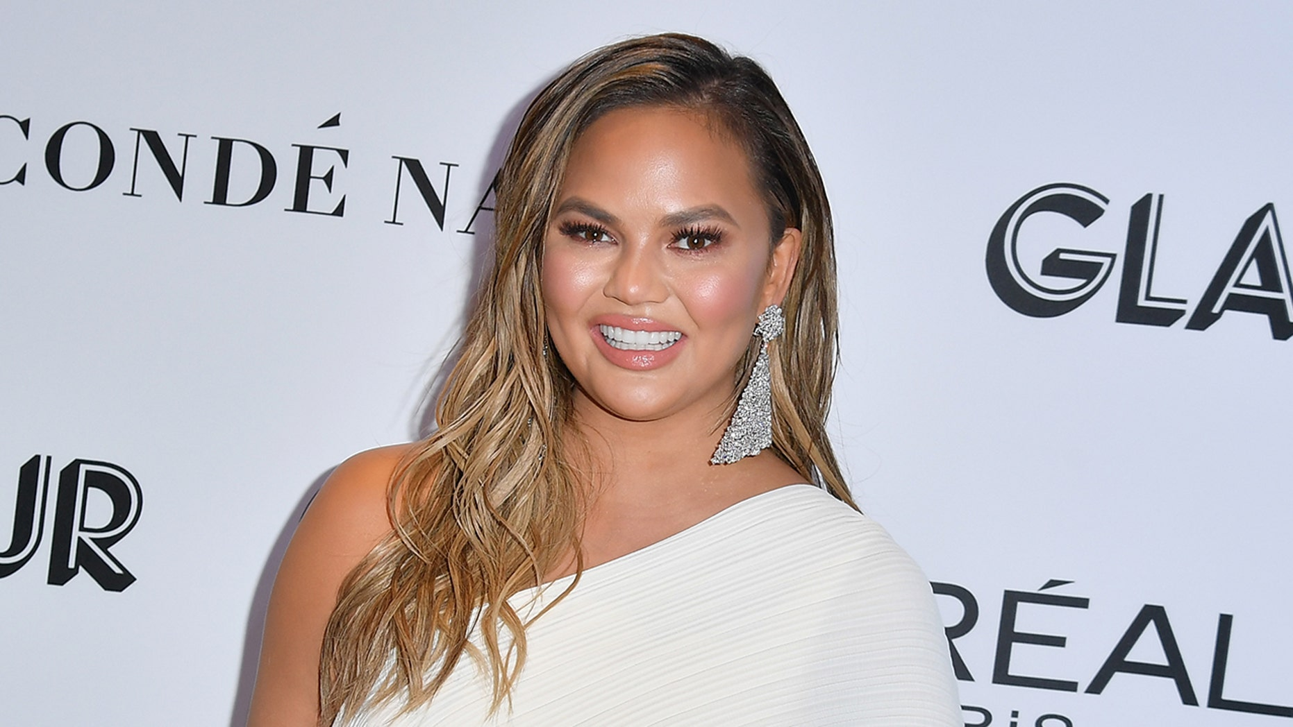 1b34df3b2081c Chrissy Teigen tweeted Saturday that she is coming to terms with her post- pregnancy weight