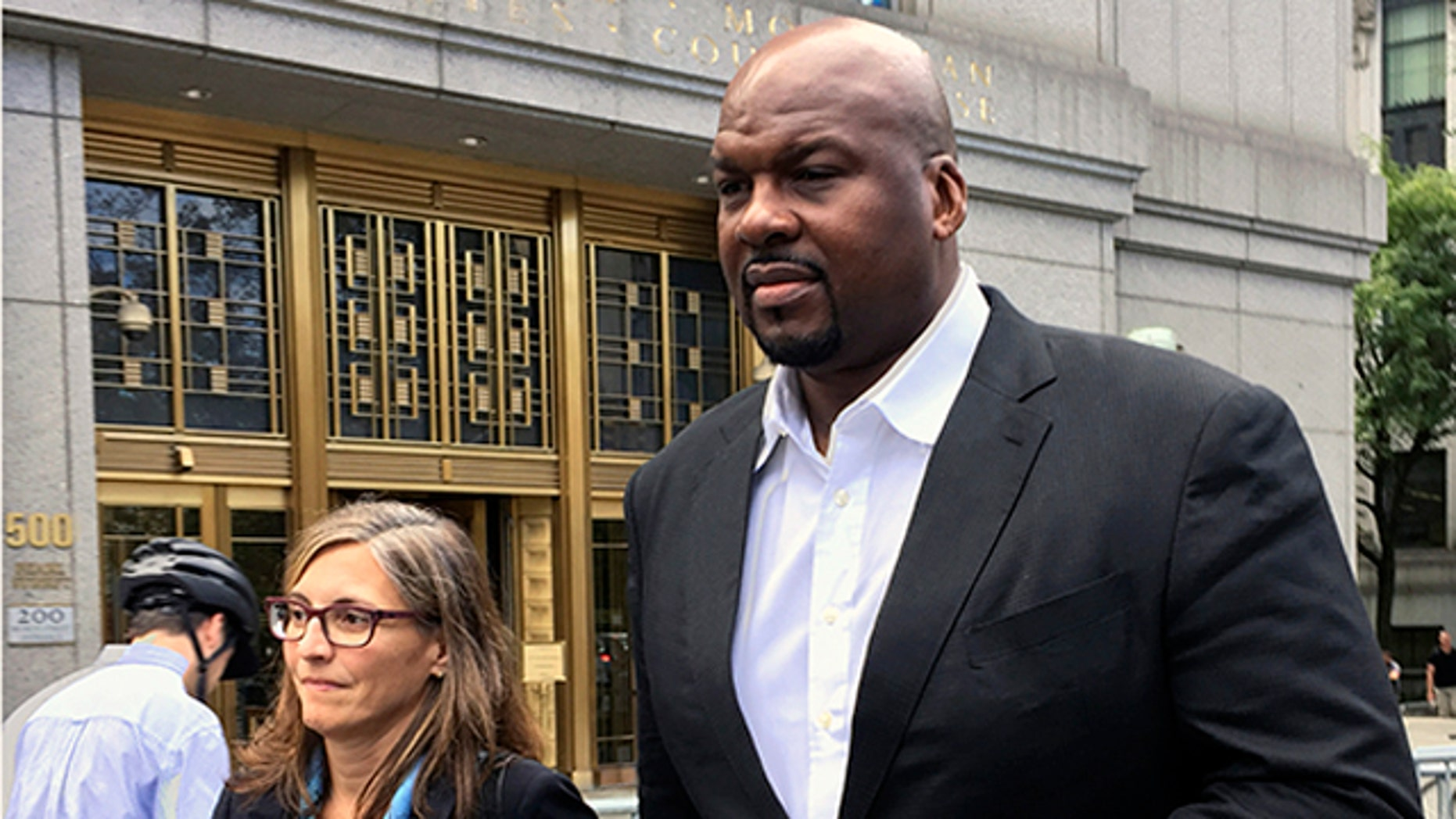 Chuck Person leaves Manhattan federal court in October 2017. (AP Photo/Larry Neumeister, File)