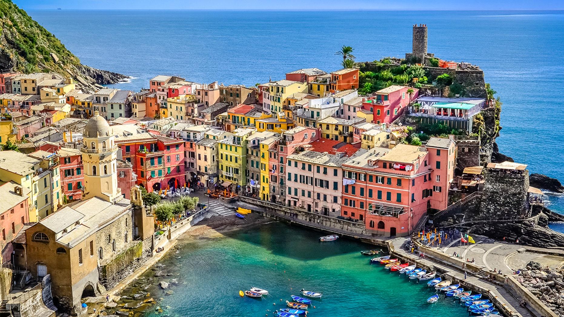 Scenic view of ocean and harbor in village Vernazza, Cinque Terre, Italy