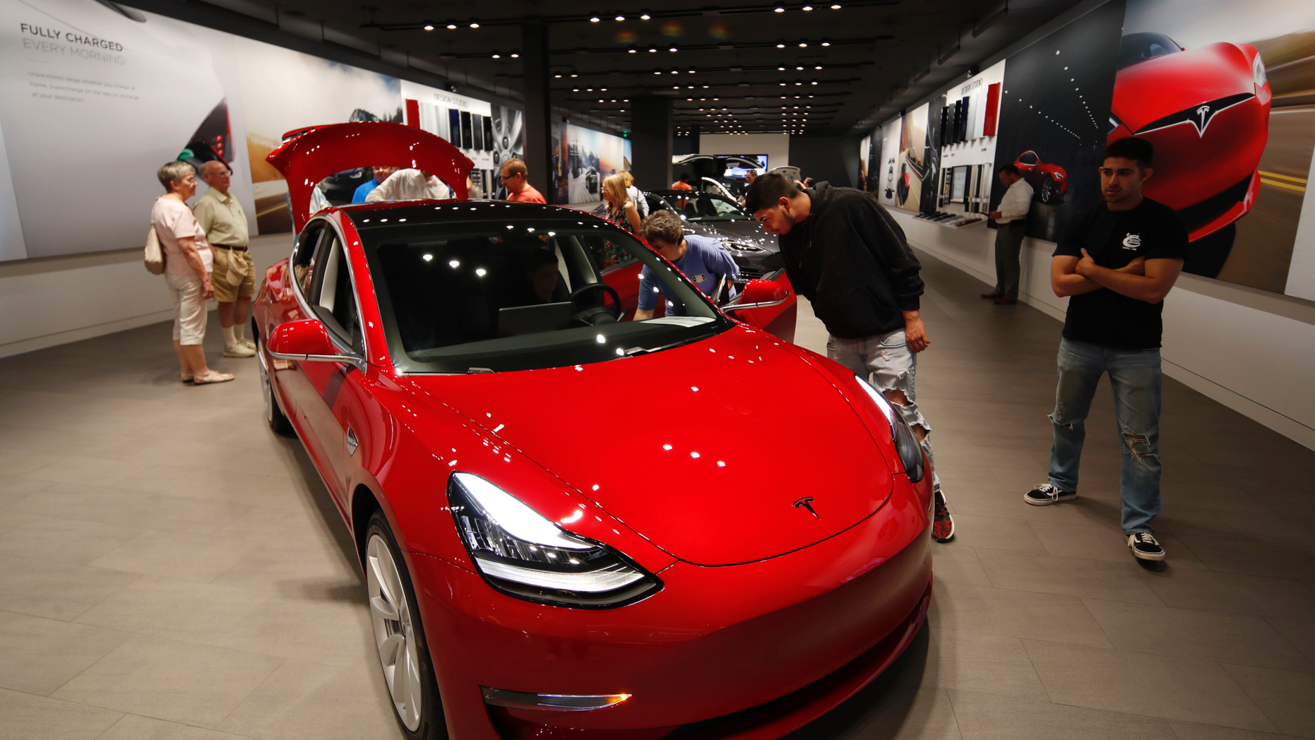 Tesla performs U-turn over store closures